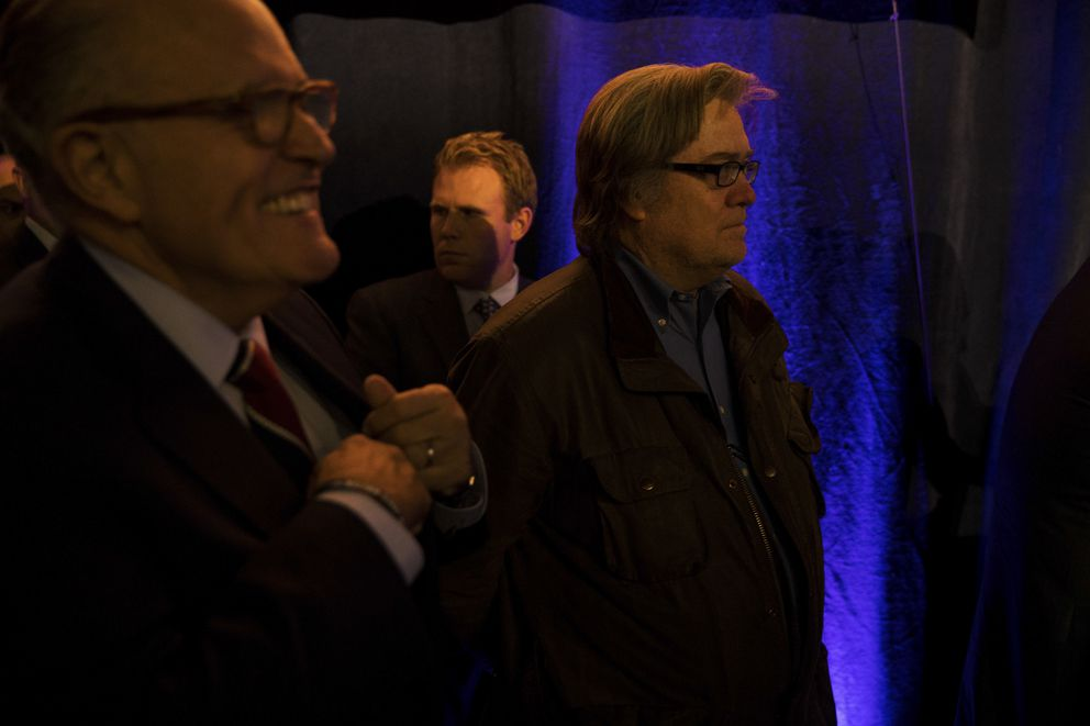 Rudy Giuliani, left, former mayor of New York City, watches with Stephen Bannon, chief executive of Donald Trump's campaign, as Trump speaks at a campaign event at the Reno-Sparks Convention Center in Reno, Nev., Nov. 5, 2016.  (Damon Winter/The New York Times)