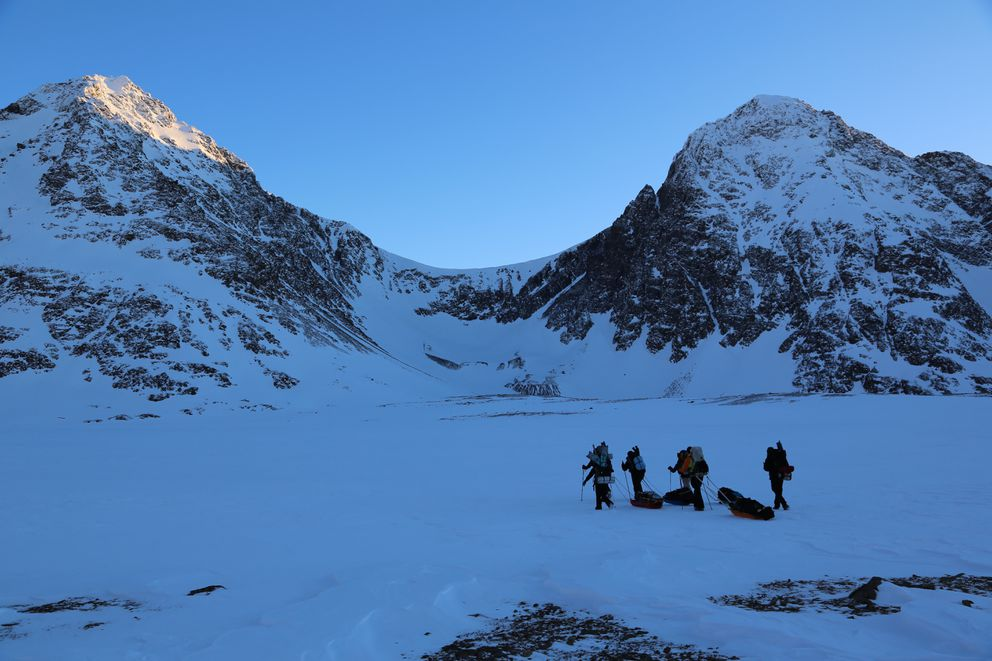 North and South Suicide Peaks stand behind Rabbit Lake as the group begins to walk onto the lake on Saturday, Jan. 2, 2021. (Photo courtesy of Frank Marley)