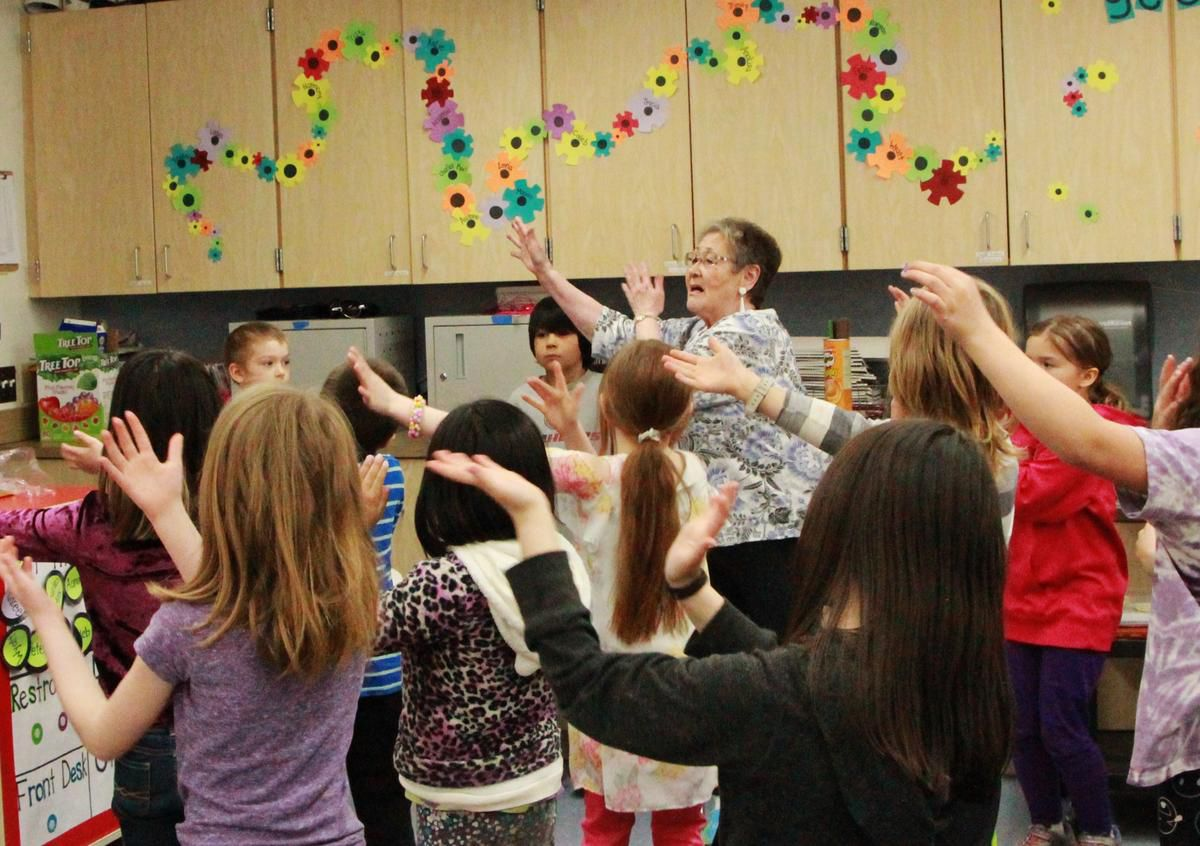 Sophie Woods leads Dillingham Elementary students in a Yupik dance. (Photo courtesy Bristol Bay Times)