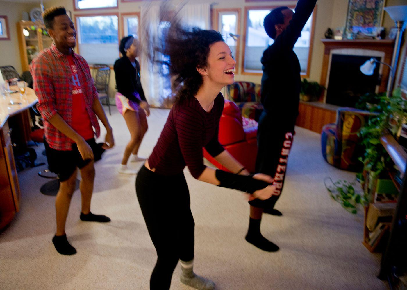 Taylor Haines dances in her living room with friends Anthoney Squalls, Destiny Grant and V.J. Vea on Thursday, November 12, 2015.