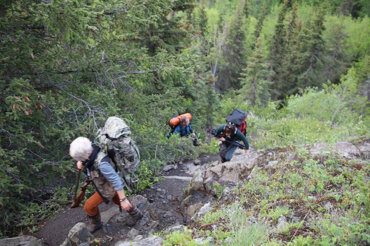 Christine Cunningham (left) leads the way as a television crew follows during a spring black bear hunt in the Kenai Mountains. (Photo by Steve Meyer)