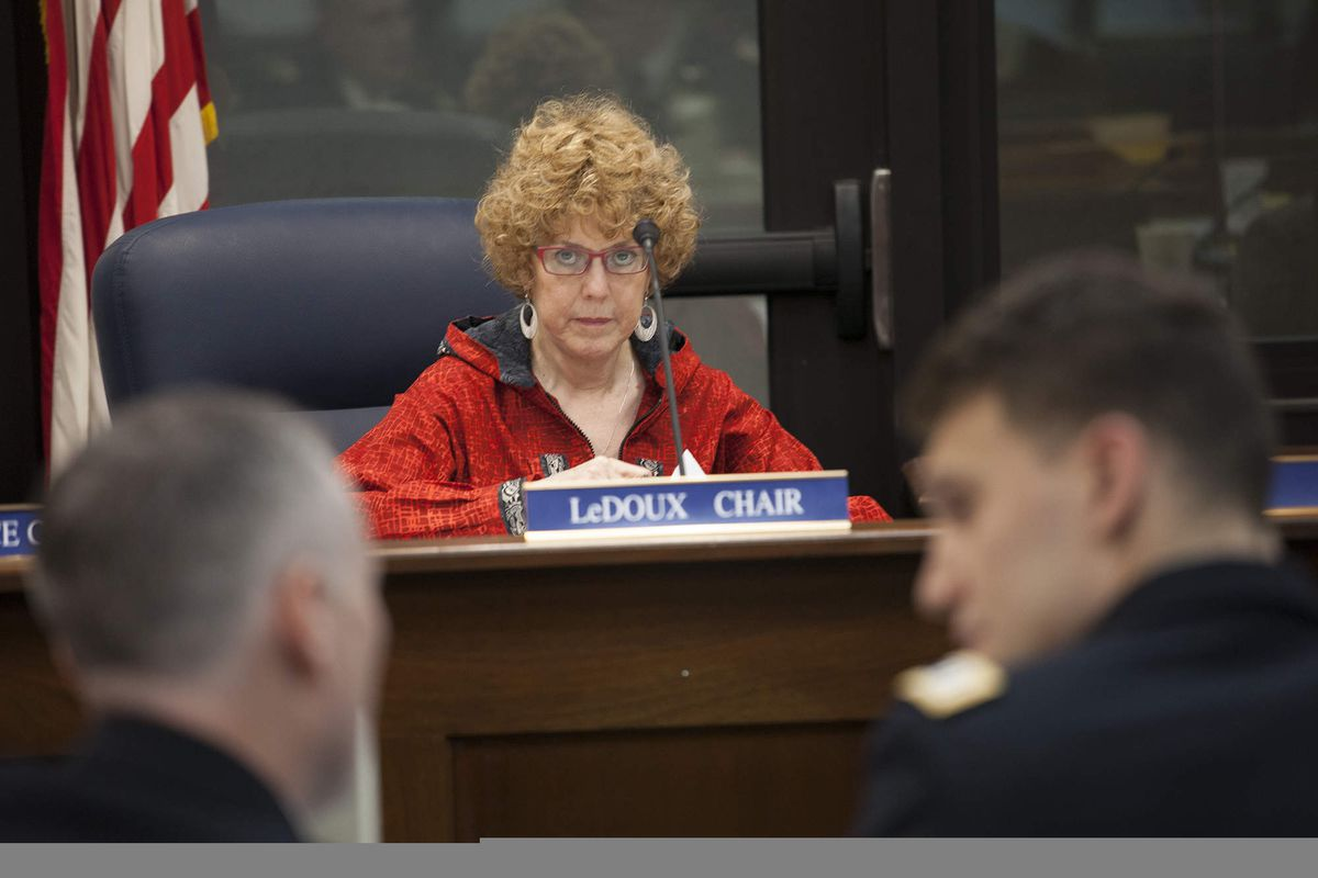 FILE - In this Jan. 22, 2016, file photo, Rep. Gabrielle LeDoux, R-Anchorage, watches National Guard Lt. Col. Christopher Weaver and Capt. Forrest Dunbar confer during a House Judiciary Committee hearing in Juneau. (AP Photo/Rashah McChesney,File)