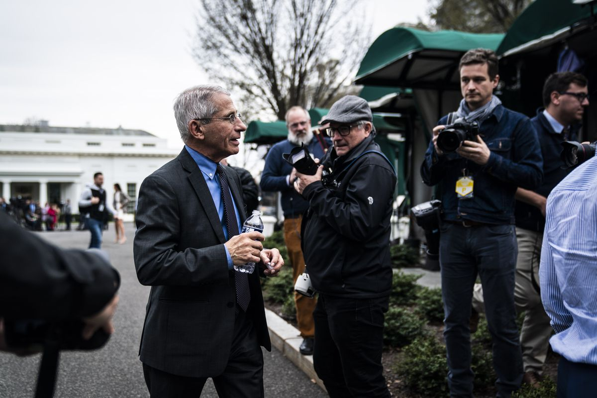 Anthony Fauci walks between television interviews on the North Lawn at the White House. (Washington Post photo by Jabin Botsford)