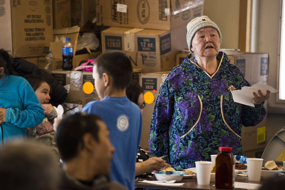Retired community heath aide Harriet Penayah speaks at the gathering. The Native Village of Savoonga hosted a community appreciation dinner on Thursday to honor Savoonga's seven community health aides. (Marc Lester / Alaska Dispatch News)