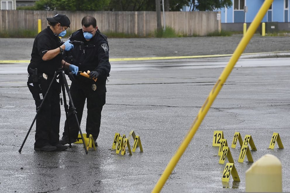 Police investigate the scene of an early morning fatal shooting along Gambell Street between Fourth Avenue and Fifth Avenue near downtown Anchorage, Alaska, Saturday, June 19, 2021. (Bill Roth/Anchorage Daily News via AP)