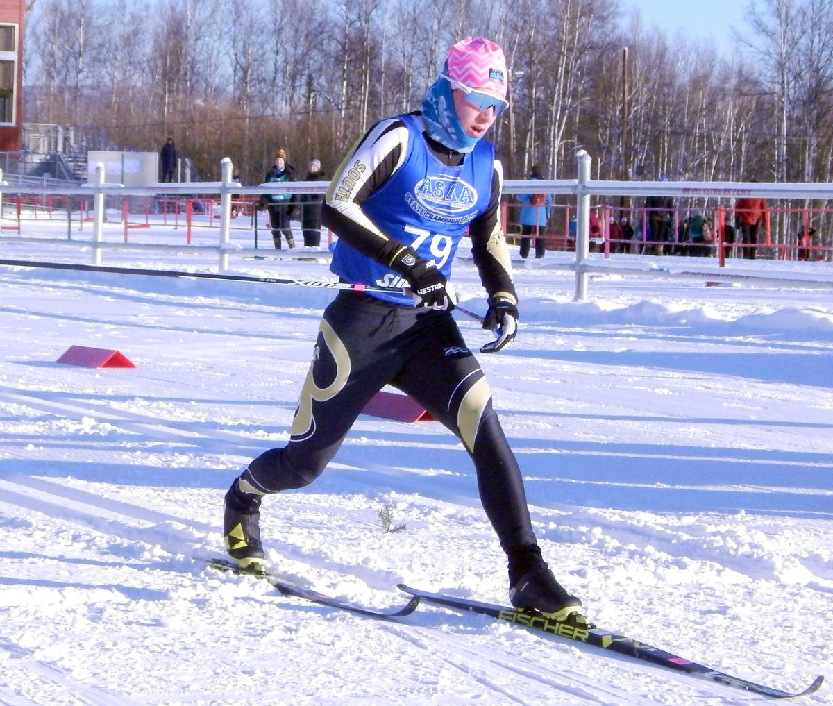 South High senior Zanden McMullen crosses the finish line as a state champion Thursday at Birch Hill Recreation Area in Fairbanks. (Danny Martin / Fairbanks Daily News-Miner)