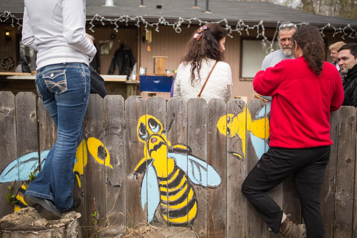 "Friends, family and neighbors gather at Terry Holtman's house for ""bee day."" This is the day when Holtman and his helpers transfer nearly 200,000 bees into their hives. (Loren Holmes / Alaska Dispatch News)"