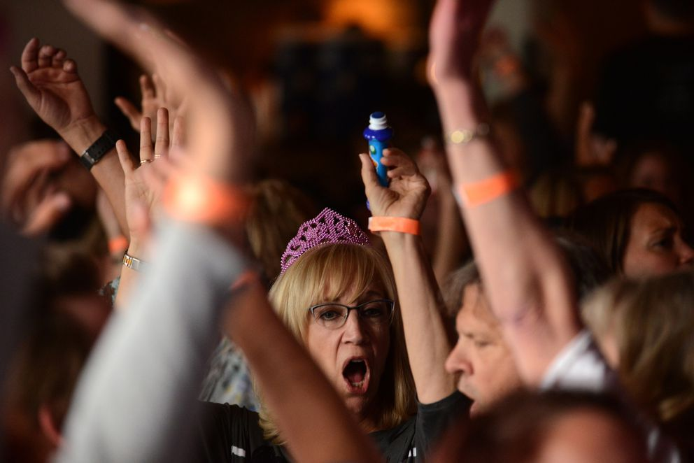 Charlotte Vilce cheers while playing Drag Queen Bingo at Williwaw in downtown Anchorage on Thursday, June 22, 2017. The Anchorage PrideFest event is a fundraiser for Identity Inc. where bingo winners have the chance to be made up as a drag queen and compete to collect the most dollar bills from the rest of the audience. (Bob Hallinen / Alaska Dispatch News)
