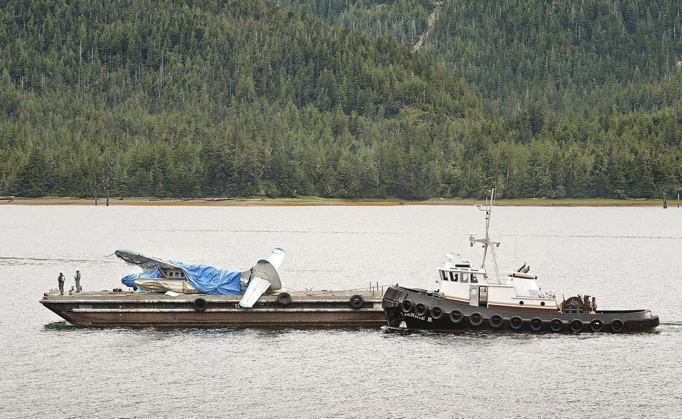 This Saturday, July 14, 2018, photo shows a Taquan Air plane that was involved in a crash July 10, 2018, on Prince of Wales Island being barged into Ketchikan. (Dustin Safranek / Ketchikan Daily News)