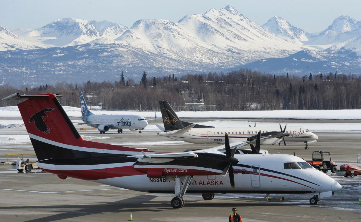 A Ravn Alaska Dash 8 sits parked at Ted Stevens Anchorage International Airport on Monday, March 23, 2020. Ravn has announced that it is temporaryly reducing its workforce by 150 employees as a result of a sharp reduction in air travel due to the coronavirus pandemic. (Bill Roth / ADN)