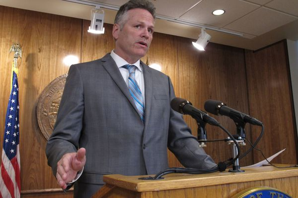 FILE - In this June 28, 2019 file photo, Alaska Gov. Mike Dunleavy speaks to reporters about his budget vetoes at the state Capitol in Juneau, Alaska. President Donald Trump is weighing in on the effort to potentially recall Dunleavy, saying Democrats are treating the first-term Republican governor unfairly. (AP Photo/Becky Bohrer, File)