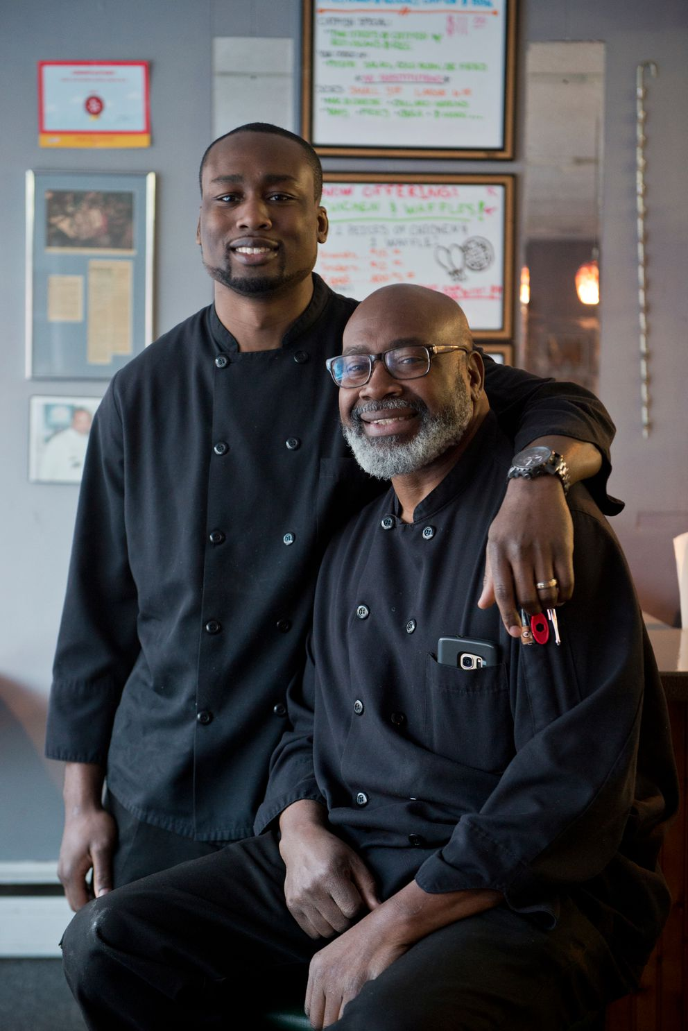 "Roscoe ""Roc"" Wyche IV, left, and his father Roscoe Wyche III opened Roscoe's Catfish and Barbecue's current location at 120 E. Sixth Ave. in 2014. They will soon open another restaurant inside the Aviator Hotel Anchorage downtown. (Marc Lester / Alaska Dispatch News)"