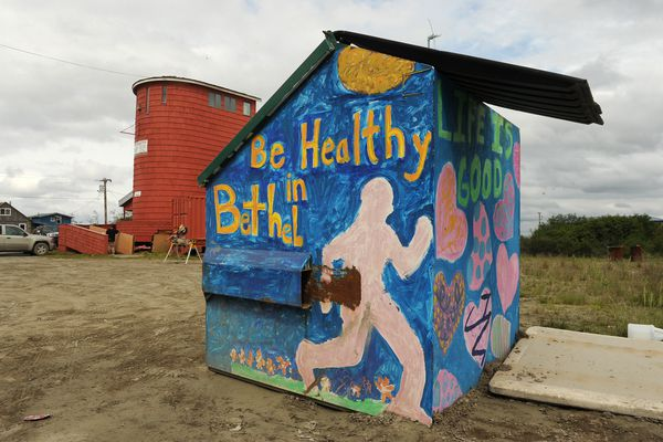 """Be Healthy in Bethel,"" proclaims a painted dumpster near the Bethel Family Clinic in Bethel, AK on Tuesday, July 1, 2014."