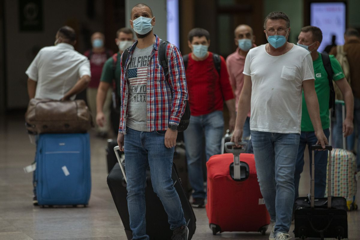 Passengers arrive at the Barcelona airport in Barcelona, Spain, Tuesday, June 30, 2020. (AP Photo/Emilio Morenatti)