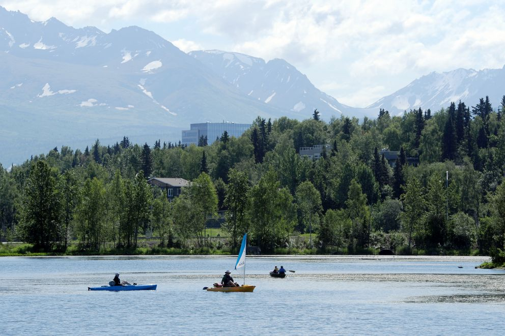 Watercraft ply the surface of Westchester Lagoon on a sunny day. (Erik Hill / ADN)