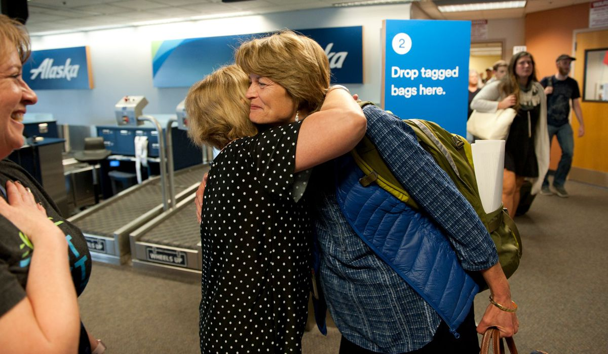 Lisa Murkowski gets a hug from Mandy Odenheimer as she arrives in Sitka Friday afternoon, July 28, 2017.  (James Poulson / Sitka Sentinel)
