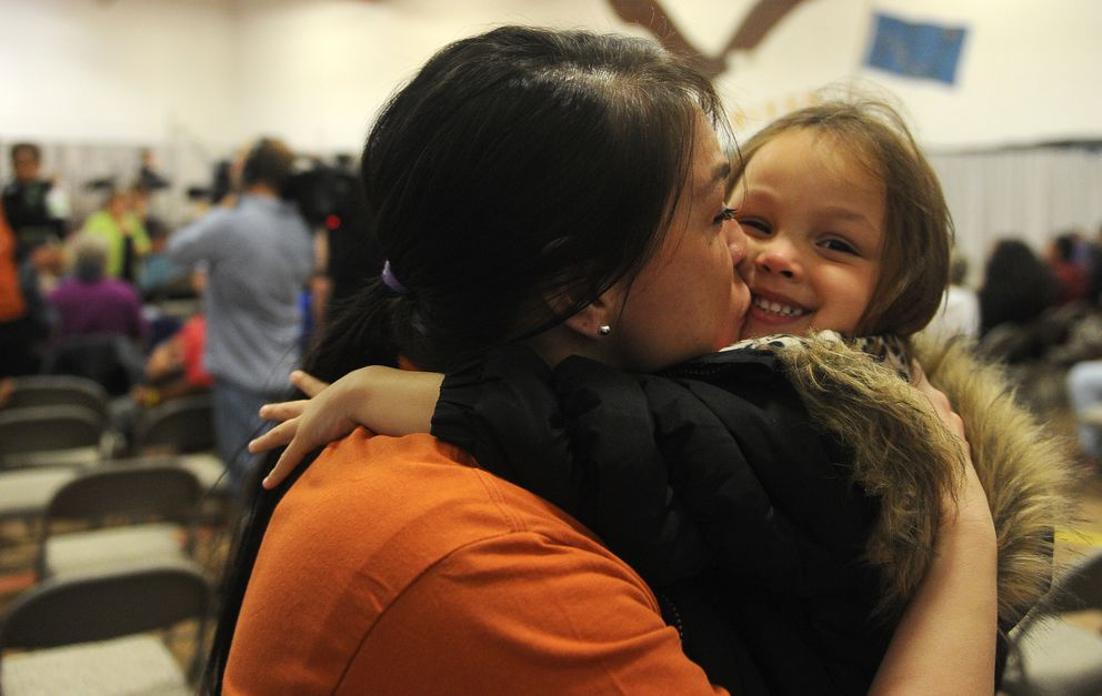 Hiland Mountain Correctional Center inmate Brandy Varney scoops up one of her daughters, Jakayla Duarte, as she arrived at the prison in Eagle River on Saturday. Varney was later on stage for the performance of her lullaby to her children Markayla Duarte and Jakayla Duarte. (Bob Hallinen / Alaska Dispatch News)