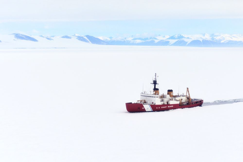 The Coast Guard's Polar Star breaks ice in Antarctica's McMurdo Sound, clearing a path for a cargo vessel to deliver supplies for National Science Foundation research bases. (Nick Ameen/U.S. Coast Guard/Los Angeles Times/TNS)