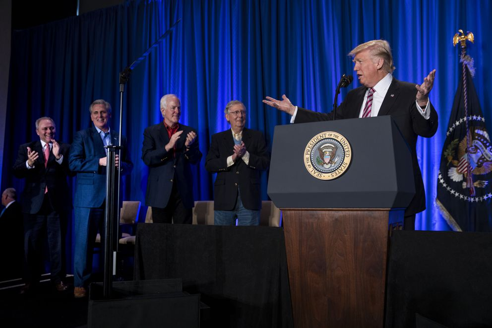 President Donald Trump speaks at the Congress of Tomorrow Republican Member Retreat on Thursday. From left: House Majority Whip Steve Scalise, House Majority Leader Kevin McCarthy, Senate Majority Whip John Cornyn and Senate Majority Leader Mitch McConnell. (Doug Mills/The New York Times)