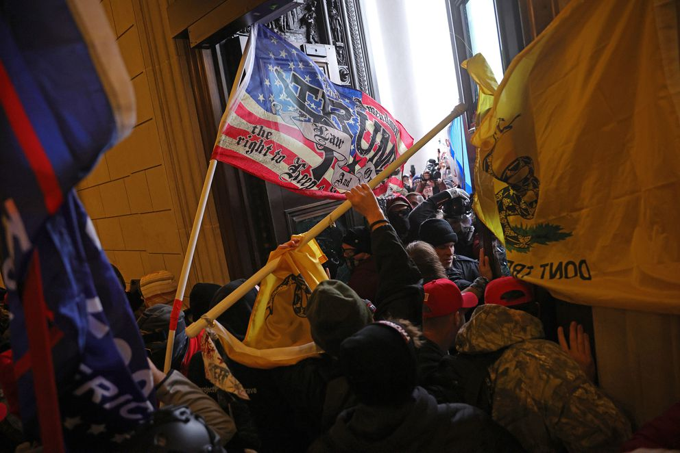 Rioters supporting U.S. President Donald Trump break into the U.S. Capitol on Wednesday, Jan. 6, 2021 in Washington, D.C. (Win McNamee/Getty Images/TNS)