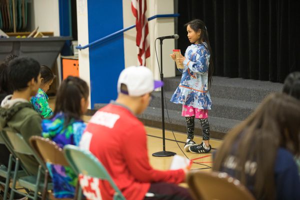 Chevak 3rd grader Jemima Pingayak spells a word during the Statewide Yup'ik Spelling Bee for Beginners Saturday, April 13, 2019, at College Gate Elementary School. (Loren Holmes / ADN)
