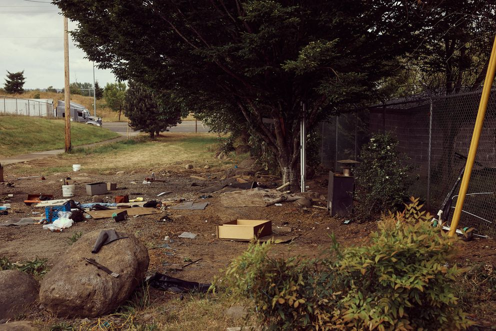 A few belongings are seen where Jeremy Wooldridge's campsite once stood on May 20, 2021, in Portland, Ore. Photo by Mason Trinca for The Washington Post