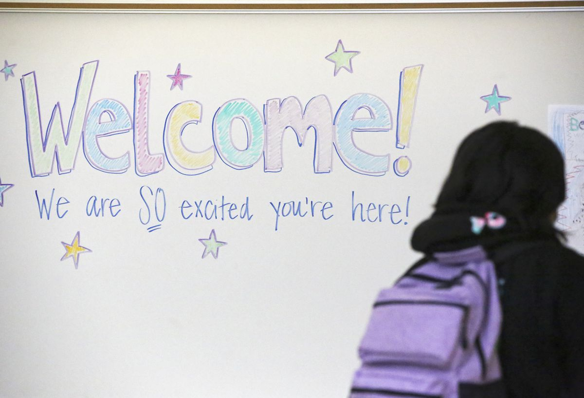 A student walks toward her classroom at Begich Middle School on Tuesday, March 16, 2021. (Emily Mesner / ADN)