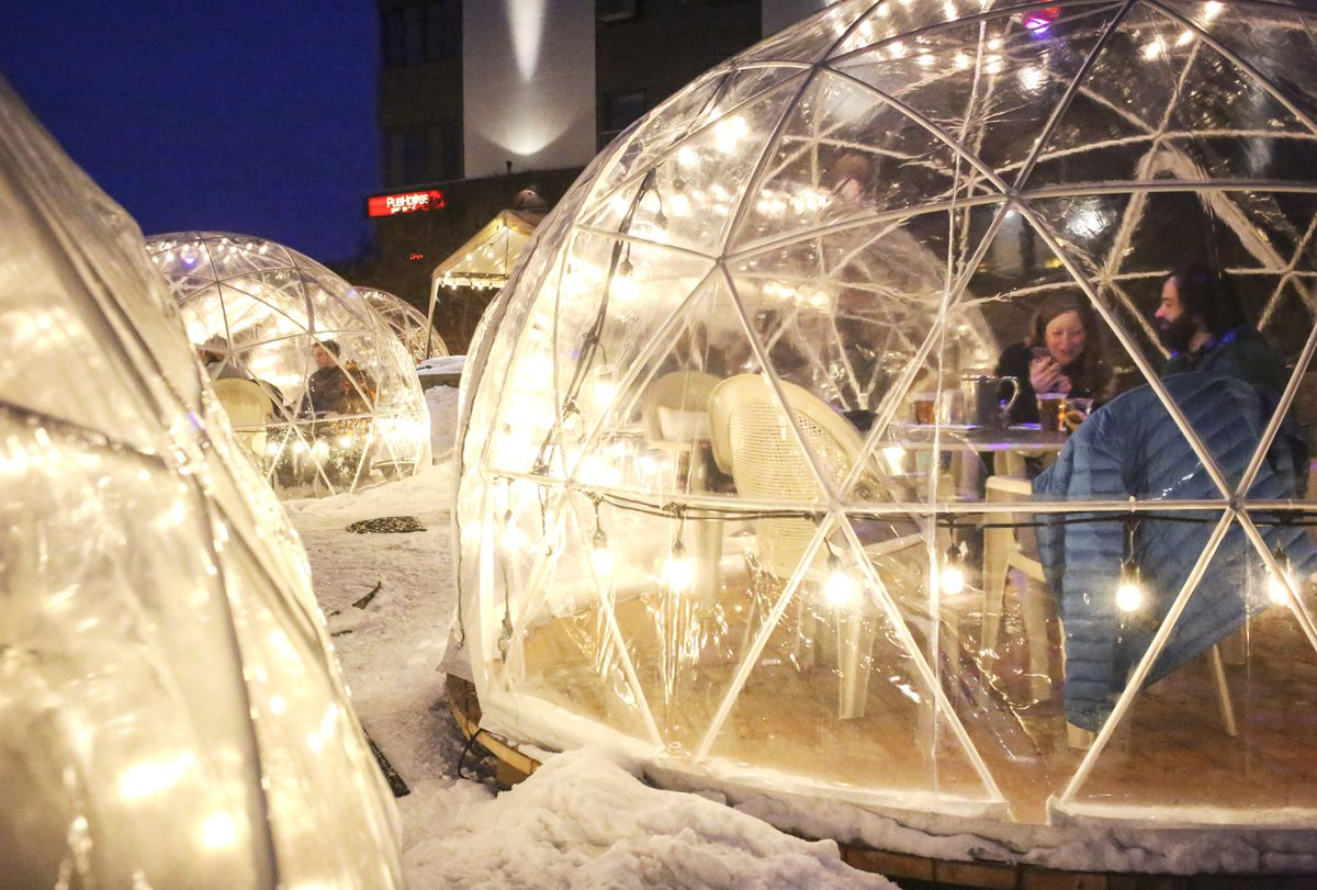 People dine in the PubHouse restaurant's outdoor dining domes at the Inlet Tower in Anchorage on Saturday, Nov. 28, 2020. (Emily Mesner / ADN)