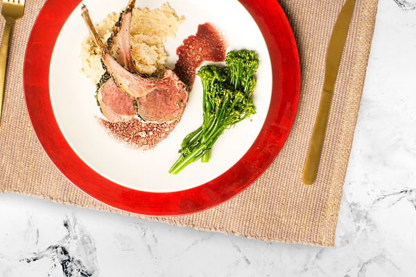 Frenched Rack of Lamb with Herbs & Root Vegetable Puree, Blanched Broccolini and Simple Red Wine Sauce