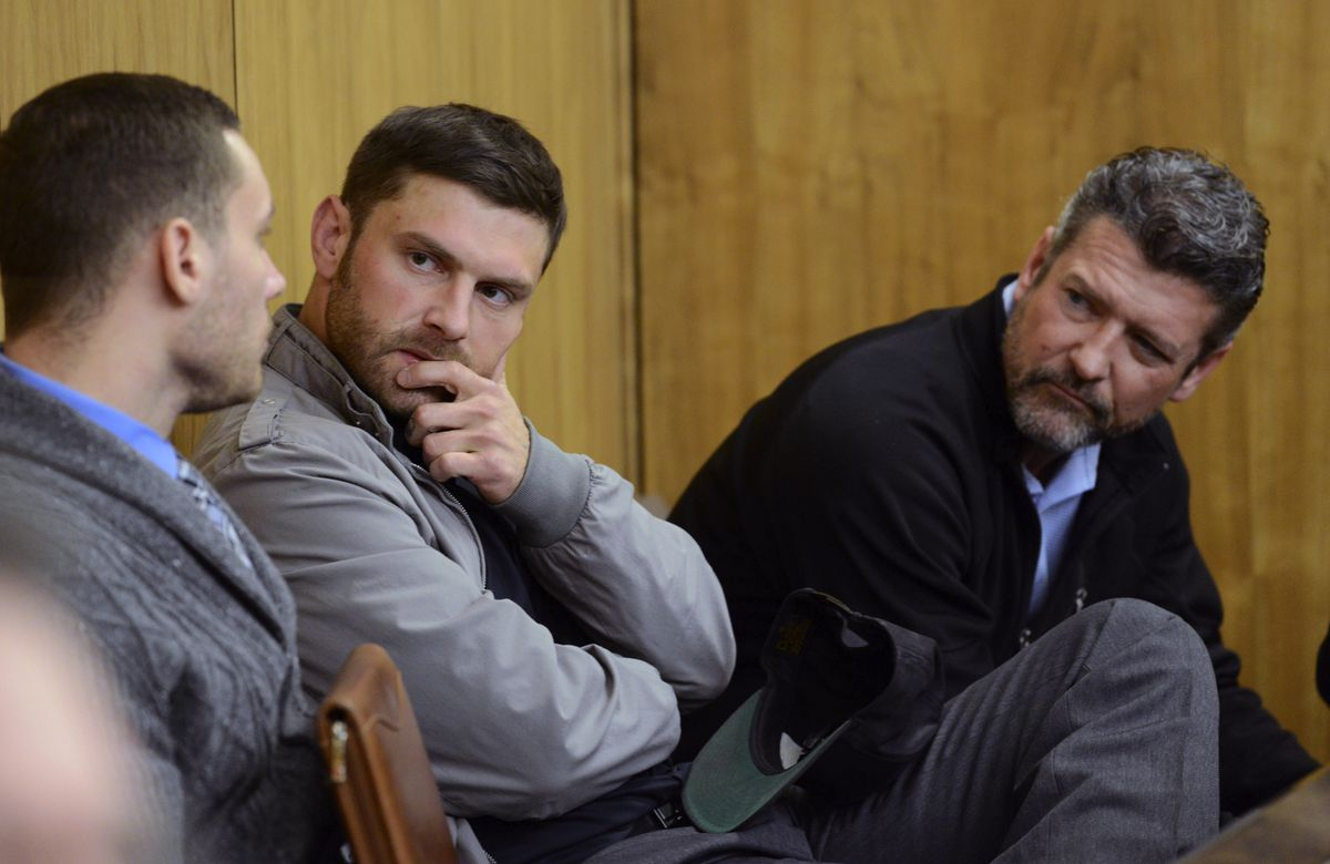 In this Oct. 3, 2018, file photo, Track Palin, center, and his father Todd Palin, right, talk with an unidentified man before Track Palin's change of plea hearing in Veterans Court at the Boney Courthouse in Anchorage. (Bob Hallinen/ADN)