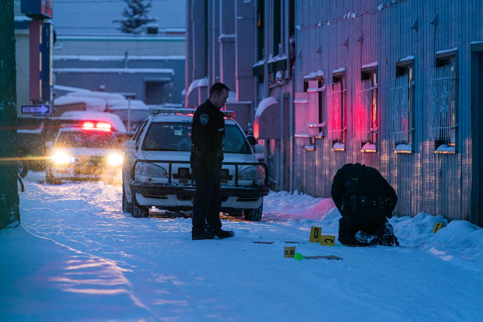 Anchorage police investigate a shooting at the Black Angus Inn Tuesday, Dec. 3, 2019. According to an alert sent out by police, one man was shot in the upper body and transported to a hospital. (Loren Holmes / ADN)