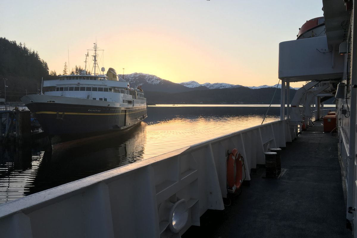 The MV Malaspina sits at the dock in Auke Bay, near Juneau, as the MV LeConte pulls away from the dock early on March 28, 2019. Both ships are part of the Alaska Marine Highway System. (Photo by Nat Herz / Alaska's Energy Desk)
