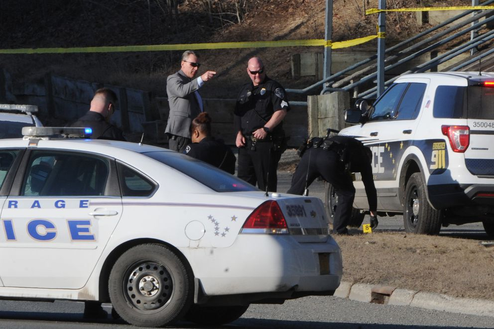 Anchorage police investigate an officer-involved shooting on A Street on Monday, April 1, 2019. (Bill Roth / ADN)