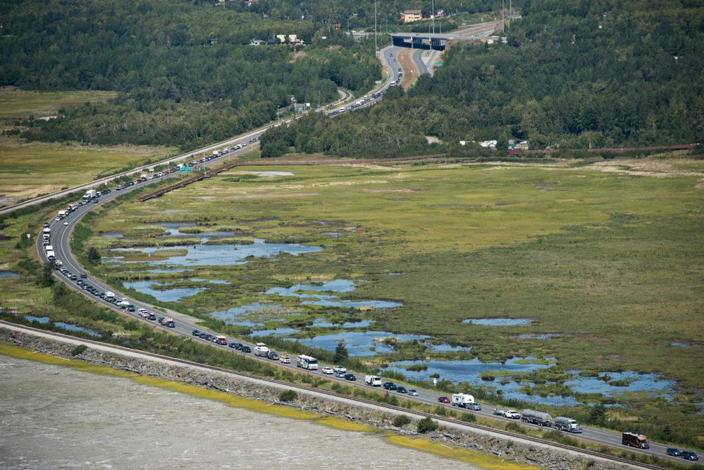 Southbound traffic is backed up on the Seward Highway near Potter Marsh on Tuesday, July 19, 2016, due to firefighting activity in the area of McHugh creek. (Marc Lester / Alaska Dispatch News)