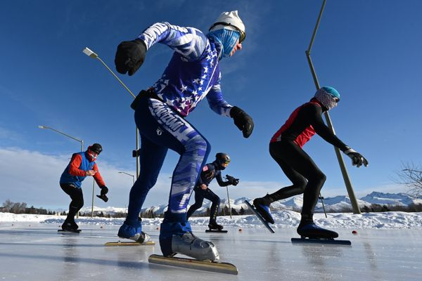 Adam Verrier, foreground, won the 50K race, 129 laps around the speed skating oval at Cuddy Family Midtown Park, during the Alaska Speedskating Club races held on Sunday, Feb. 14, 2021. (Bill Roth / ADN)