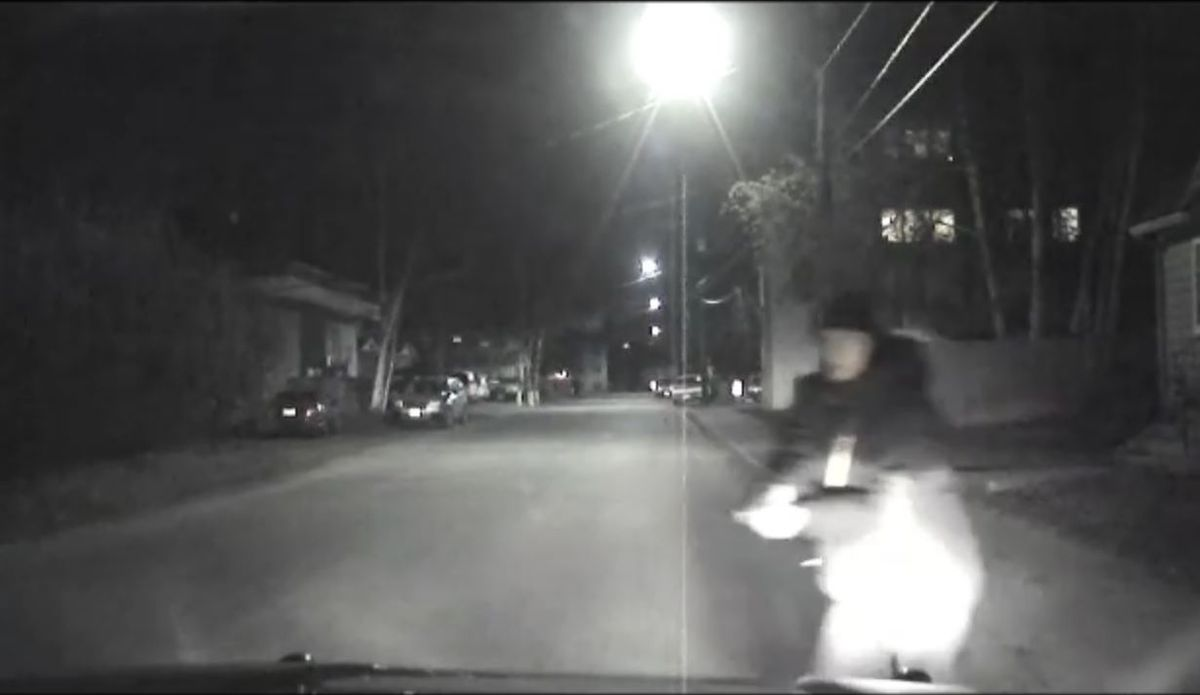 A still from a dashboard camera video released following the shooting of a Fairbanks Police Department officer shortly after midnight on Sunday, Oct. 16, 2016. The video shows a man walking down a sidewalk before crossing in front of the patrol vehicle with what appears to be a gun in his hand. (Fairbanks Police Department)
