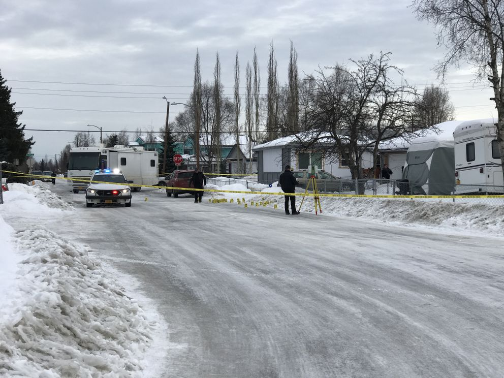 Anchorage police investigate a fatal officer-involved shooting near 16th Avenue and Columbine Street early Thursday morning, March 7, 2019. (Anne Raup / ADN)