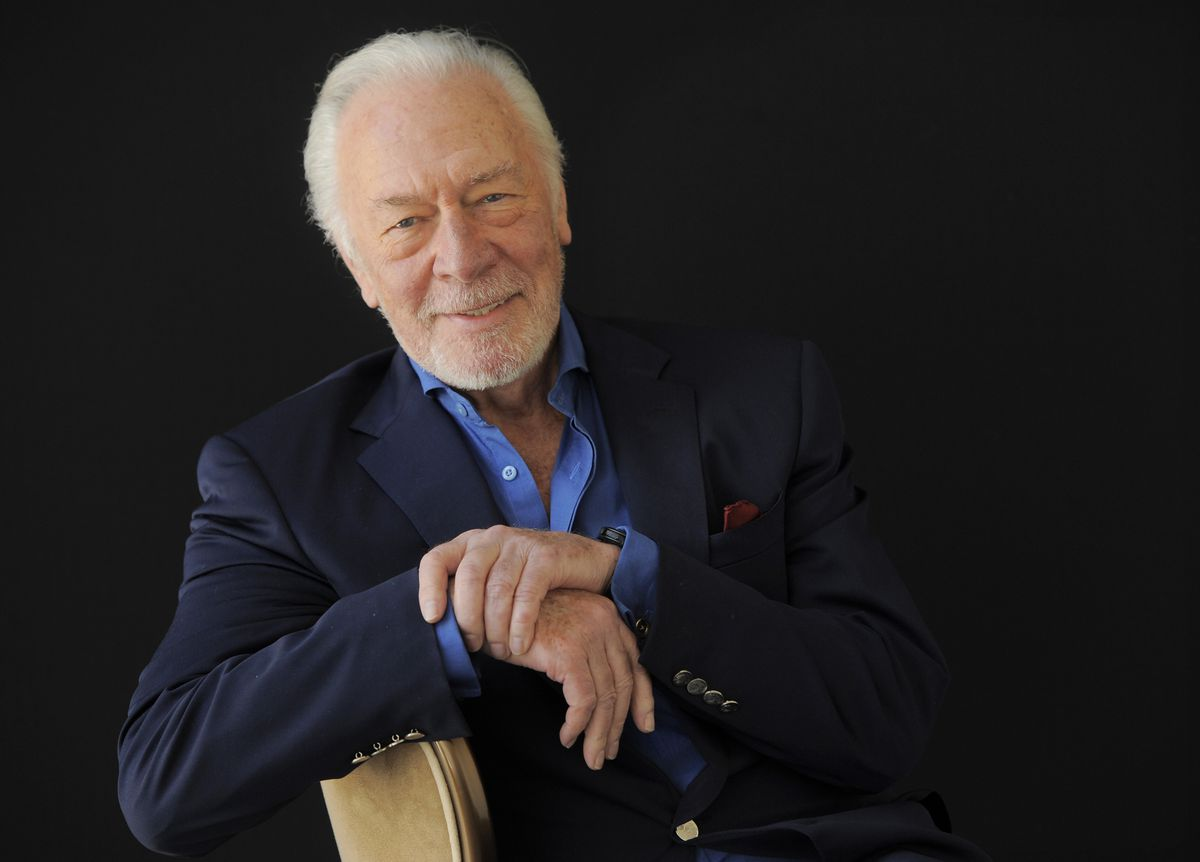 """FILE - Christopher Plummer poses for a portrait on July 25, 2013, in Beverly Hills, Calif. Plummer, the dashing award-winning actor who played Captain von Trapp in the film """"The Sound of Music"""" and at 82 became the oldest Academy Award winner in history, has died. He was 91. Plummer died Friday morning, Feb. 5, 2021, at his home in Connecticut with his wife, Elaine Taylor, by his side, said Lou Pitt, his longtime friend and manager.. (Photo by Chris Pizzello/Invision/AP, File)"""