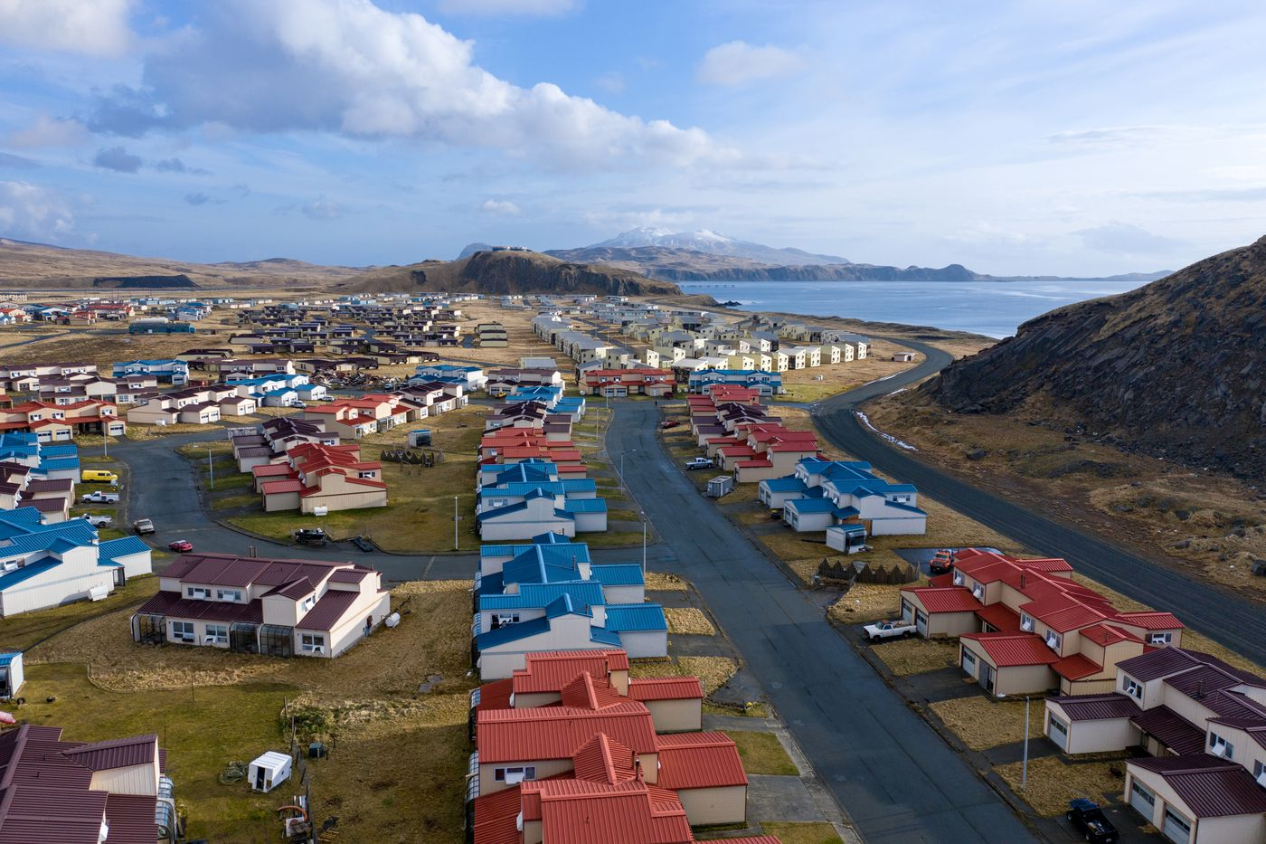 The city of Adak, Alaska. At its height, thousands of people lived on Adak. Now, the block of houses in the foreground are among the only habitable buildings left in the town. Photographed April 29, 2019. (Cale Green)