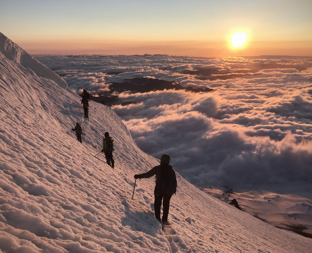 "On our reroute dubbed the ""endless traverse,"" we were treated to a stunning sunrise as we headed toward the summit of Mount Rainier on July 16. (Vicky Ho / Alaska Dispatch News)"