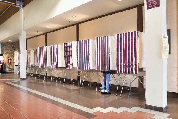 A voter uses a polling booth on Tuesday, August 21, 2018 during primary election day at Ketchikan Precinct 2 in the Plaza building in Ketchikan, Alaska. (Dustin Safranek /Ketchikan Daily News via AP)
