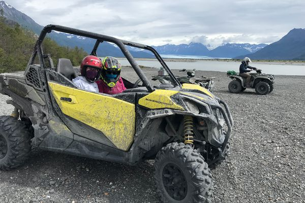 Alli Harvey and Reesa Hoskins in the side by side ATV, Wes Hoskins and Knik Glacier in the background. (Photo by Bryan Scoresby)