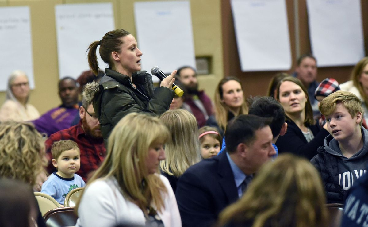 Michelle Strange speaks to the crowd during a public forum on the future of Chugiak-Eagle River schools on Monday, Dec. 9, 2019 at Mirror Lake Middle School in Chugiak. (Matt Tunseth / Chugiak-Eagle River Star)