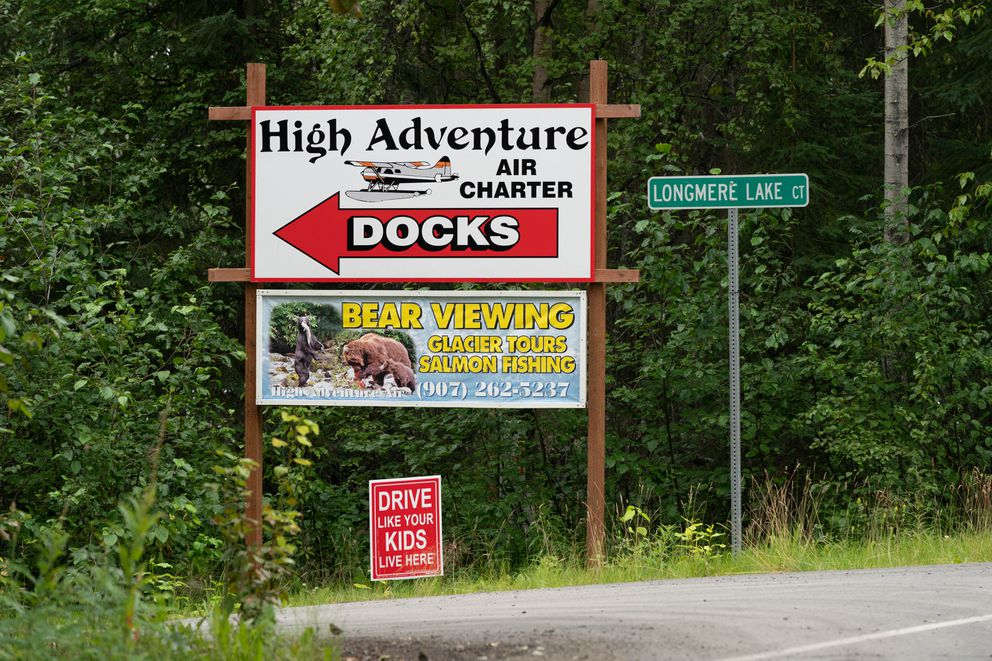 A sign for High Adventure Air Charter on Longmere Lake in Soldotna, on Friday, July 31, 2020. (Loren Holmes / ADN)