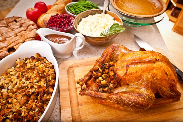 Roast turkey and all the accompaniments, including stuffing, green bean, squash, mash potato, gravy, cranberry sauce, pumpkin pie. The traditional Christmas and Thanksgiving dinner table. (Getty Images)