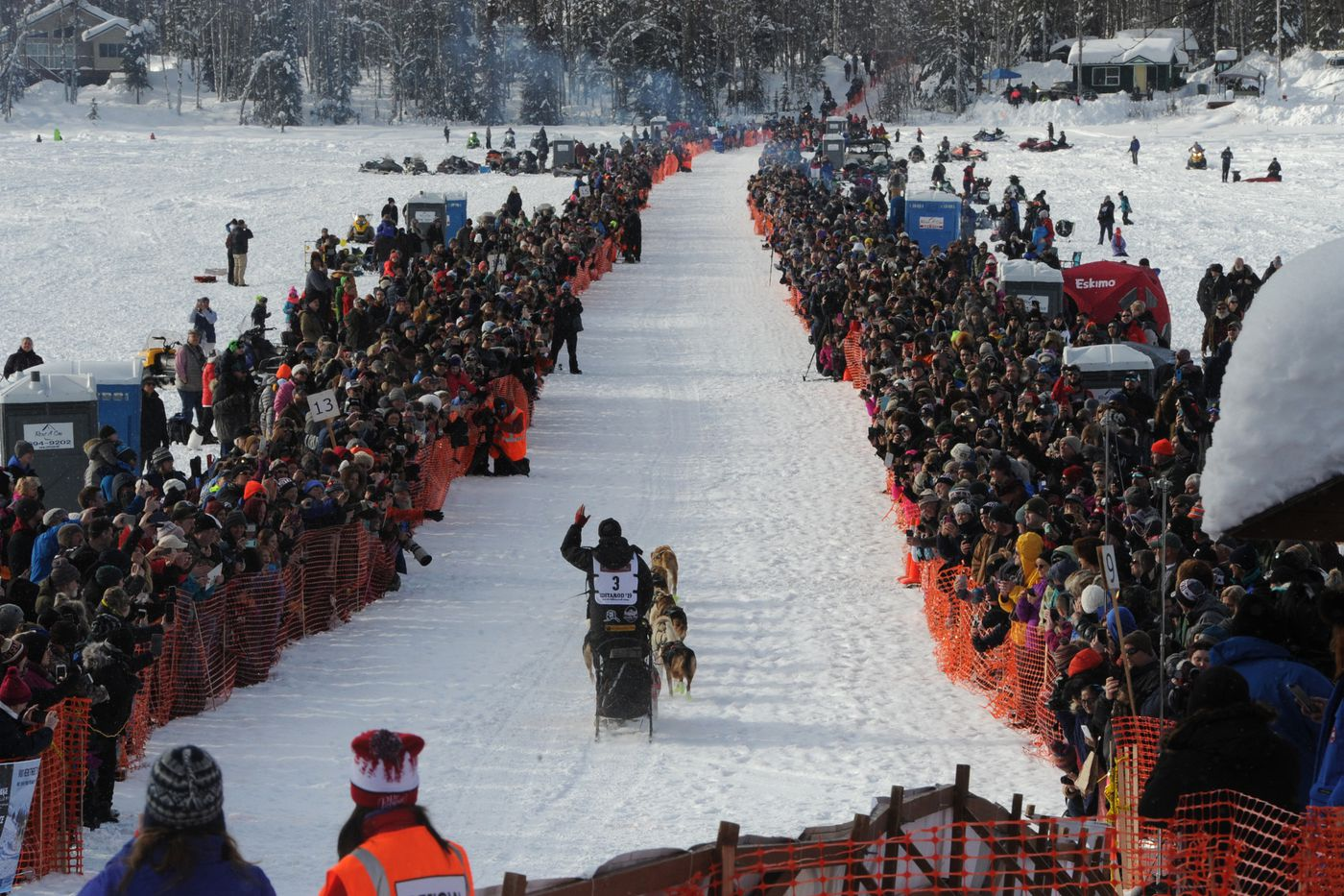Musher Matt Hall waves to the crowd gathered on Willow Lake during the restart of the Iditarod on Sunday afternoon, March 3. (Bill Roth / ADN)