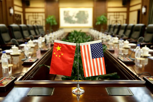 FILE PHOTO: Flags of U.S. and China are placed for a meeting between Secretary of Agriculture Sonny Perdue and China's Minister of Agriculture Han Changfu at the Ministry of Agriculture in Beijing, China June 30, 2017. REUTERS/Jason Lee/File Photo