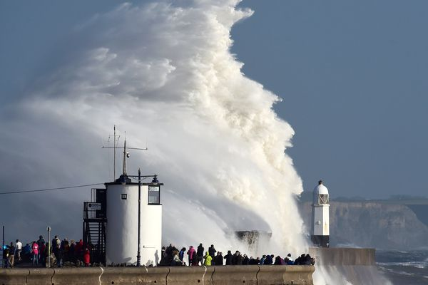 Waves crash over the lighthouse as storm Ophelia passes Porthcawl, Wales, Britain, October 16, 2017. REUTERS/Rebecca Naden