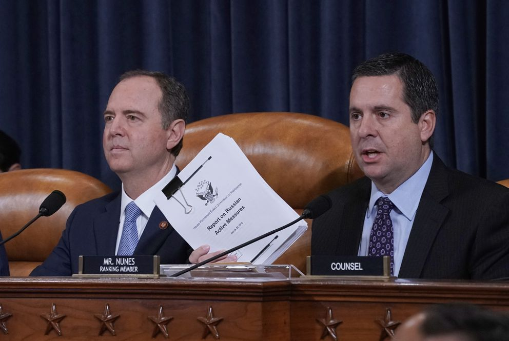 Rep. Devin Nunes, R-Calif., the ranking member of the House Intelligence Committee, joined at left by Chairman Adam Schiff, D-Calif., holds up a document he is submitting as the panel prepares to listen to former White House national security aide Fiona Hill, and David Holmes, a U.S. diplomat in Ukraine, on Capitol Hill in Washington, Thursday, Nov. 21, 2019, during a public impeachment hearing of President Donald Trump's efforts to tie U.S. aid for Ukraine to investigations of his political opponents. (AP Photo/J. Scott Applewhite)