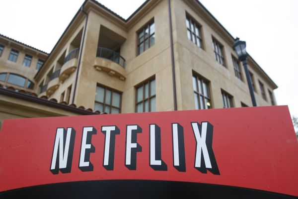 FILE - This Jan. 29, 2010, file photo, shows the company logo and view of Netflix headquarters in Los Gatos, Calif. (AP Photo/Marcio Jose Sanchez, File)